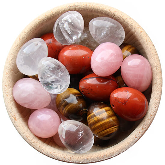 Yoni egg in wooden basket