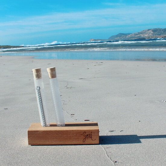 Wooden stand on the beach with rawtoothbrush